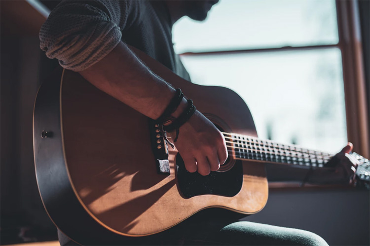 How long does it take to learn guitar? - National Guitar Academy